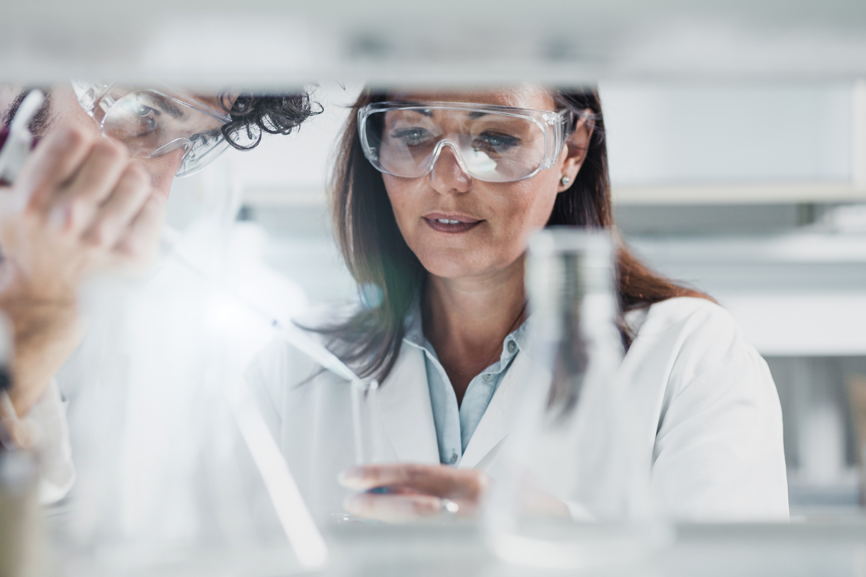 Biomedical engineers or Scientists Using an Automatic Pipette