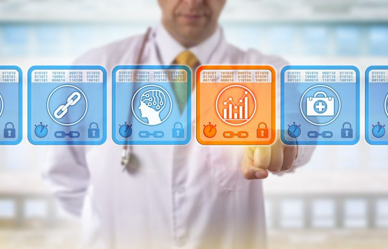 A doctor stands behind four square data icons
