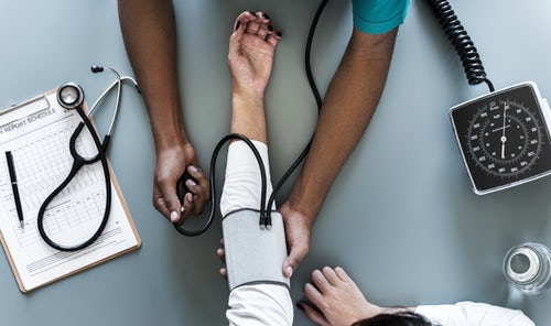 A view from above of a nurse taking a patient's blood pressure